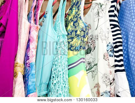 Women's dresses on hangers in the wardrobe