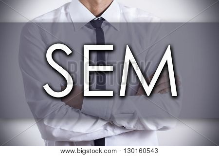 Sem - Young Businessman With Text - Business Concept
