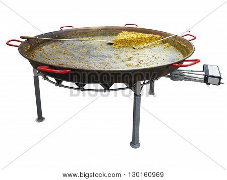Paella on giant frying pan done at the carnival isolated over white