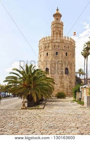 The ancient lighthouse Torre del Oro at the banks of Guadalquivir river, Seville, Spain