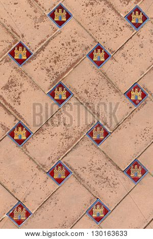 Close up of intricate tile work on the floor of Plaza de Espana, Seville, Spain