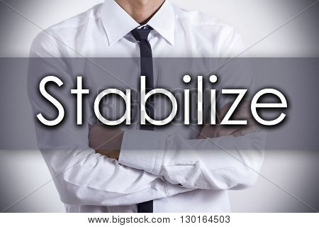 Stabilize - Young Businessman With Text - Business Concept