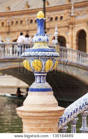 Detail of colorful artistic ceramics at Plaza de Espana, Seville, Spain