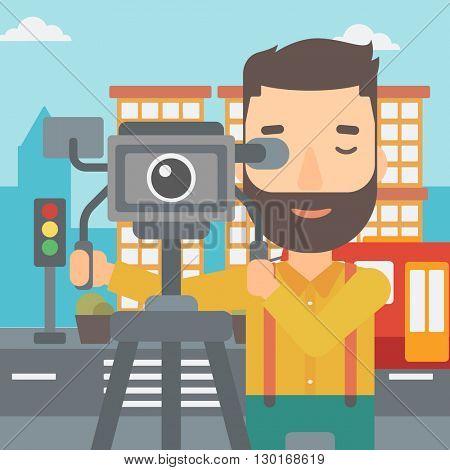 Cameraman with movie camera on a tripod.