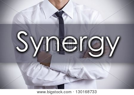Synergy - Young Businessman With Text - Business Concept