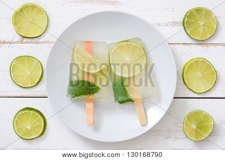 Summer lime popsicle on marble white background