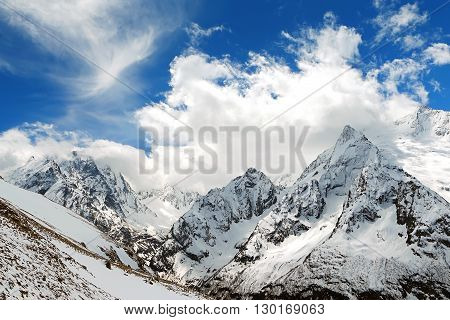 Mountain peaks in sun windy day. Caucasus Mountains region Dombay.