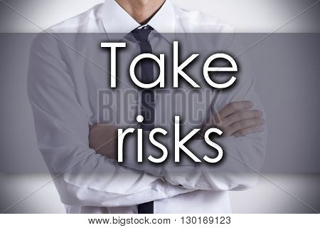 Take Risks - Young Businessman With Text - Business Concept