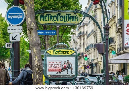 Paris France - September 12 2015: Entrance in the Paris's subway station and other cities signs people and ads.