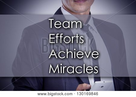 Team Efforts Achieve Miracles - Young Businessman With Text - Business Concept