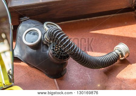 A photo with Old gas mask with hose