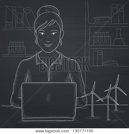 Woman working at laptop.