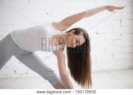 Profile Portrait Of Beautiful Woman Standing In Yoga Pose