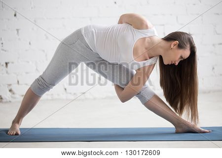 Profile Portrait Of Beautiful Woman Working Out
