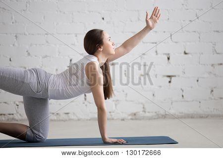 Portrait Of Beautiful Woman Doing Donkey Kick Exercise