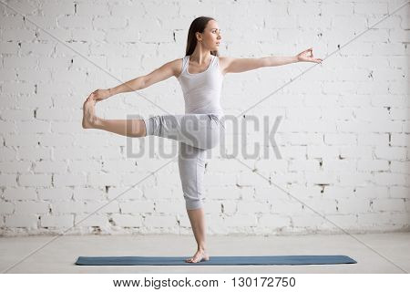 Beautiful Woman Doing Revolved Extended Hand To Big Toe Pose