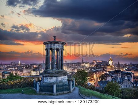 Edinburgh Against Sunset With Calton Hill In Scotland