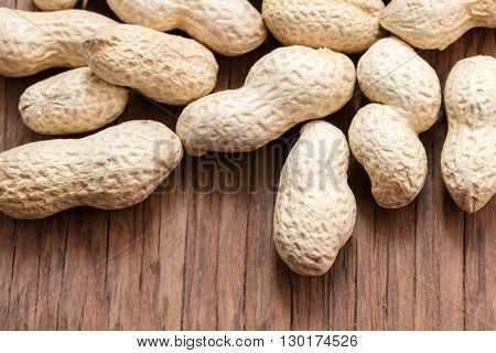 groundnut in the skin close-up on a wooden background