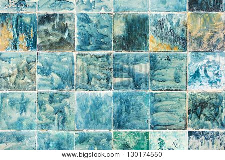 tiles hand painted in blue and green colors. Abstract background