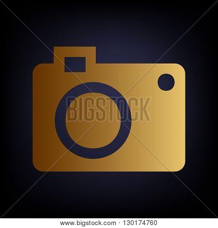 Digital camera icon. Golden style icon on dark blue background.