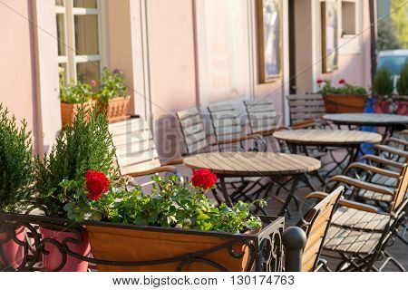 cozy outdoor cafe in early spring morning