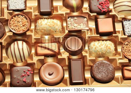 Luxurious Chocolates in various shapes and flavors in a gift box