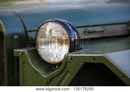 Headlight of military retro car. Selective focus.
