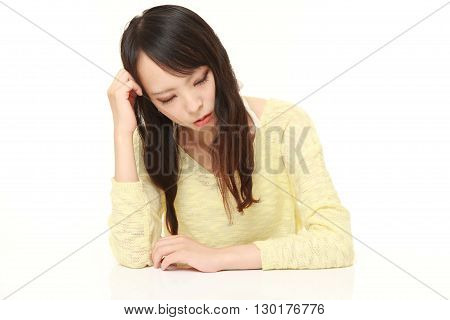 Young Japanese Woman Sleeping on the Table
