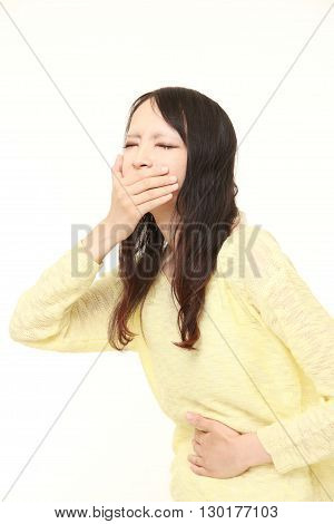 portrait of young Japanese woman feels like vomiting on white background
