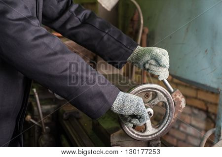 worker in protective gloves
