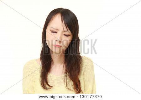 portrait of sad woman on white background