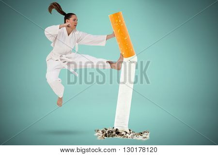 Fighter performing karate stance against green background