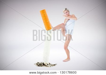 Scared woman protecting herself against grey background
