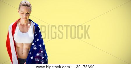 Portrait of american sportswoman unsmiling against yellow background