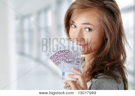 Beautiful young woman holding euros bills - real estate loan concept