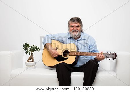 Single Old Men On White Couch With A Bonsai