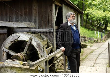 Old Man Outside On Alley