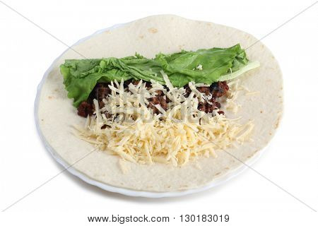 Products for burrito on a white plate
