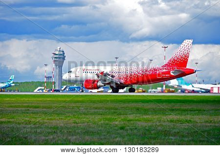 SAINT PETERSBURG RUSSIA - MAY 11 2016. Rossiya Airlines Airbus A319 airplane in new livery registration number VQ-BCP. Airplane rides on the runway after landing in Pulkovo International airport