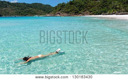 Woman snorkeling in the turquoise waters of Malaysia