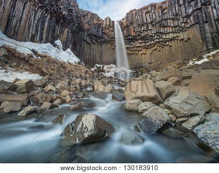 Stunning waterfall Svartifoss with basalt columns. Skaftafell national park Iceland