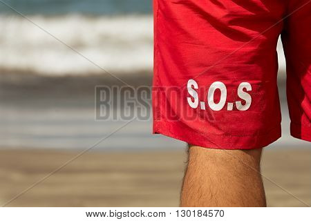 Lifeguard from behind front of the sea,detail swimwear