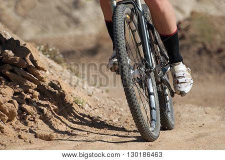 Downhill mountain bike on dirt road race