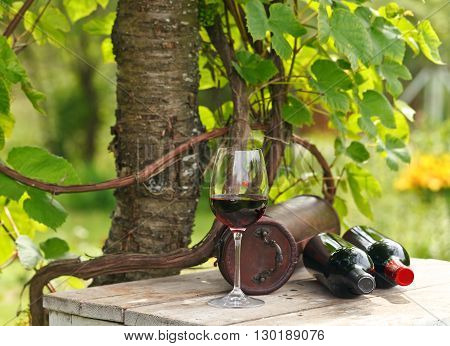 Bottles And Glass With Red Wine