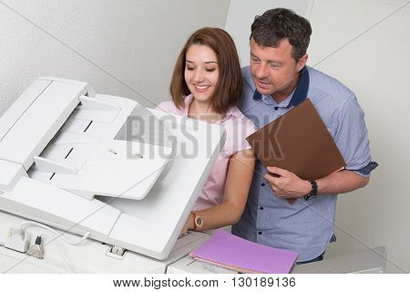 Business People Using A Copy Machine At Work