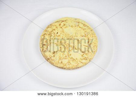 Spanish Potato Omelette On White Dish