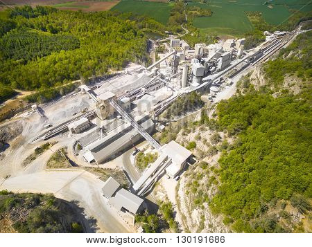 Aerial view of old lime works. Biggest Czech limestone quarry Devil's Stairs - Certovy Schody. Aerial view of industrial landscape after mining. Industry and environment in Czech Republic, Europe.