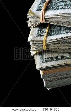 Closeup of several dollar bills isolated on white background
