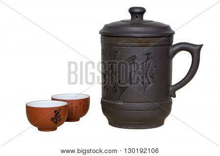 Isolated brown chinese teapot and tea cup on white screen