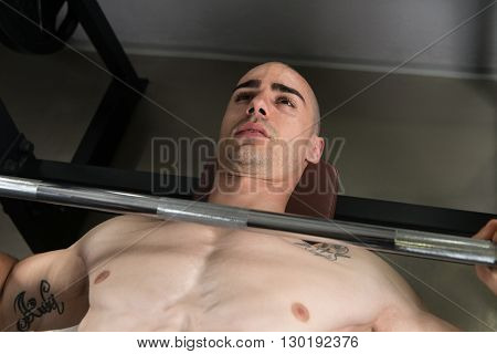 Healthy Young Man Doing Bench Press Exercise